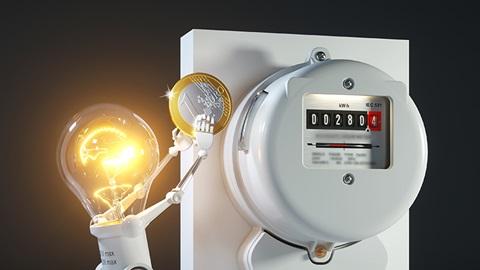 Boneco com cabeça de lâmpada a colocar uma moeda num contador de eletricidade