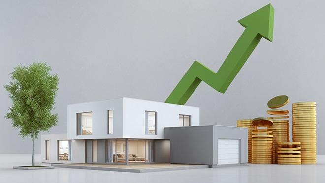 Imagem de uma vivenda grande e branca com uma seta verde por trás a indicar que os preços das rendas das casas vão aumentar