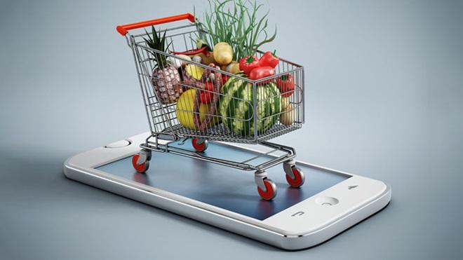 carrinho de compras em cima de um telemóvel