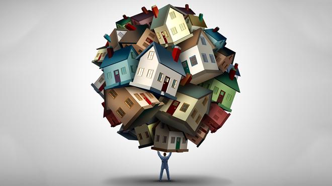 ilustração de pessoa a segurar numa bolha imobiliária com várias casas