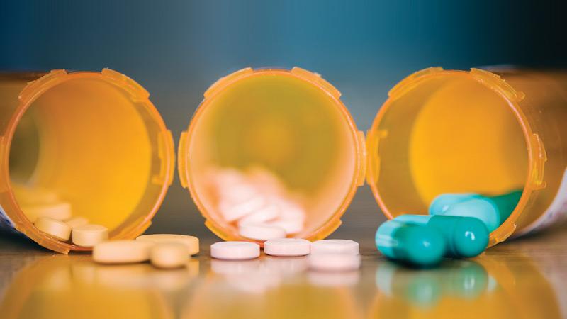 caixas de medicamentos com comprimidos